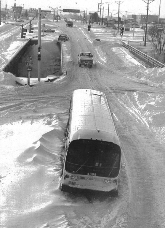 . One of the hardest hit area,Aurora a Denver suburb the main street of Colfax Ave is inundated by snow from the Christmas blizzard here 12/26.Two days after the storm cars and a bus sit abandoned on this main ave. Credit: UPI , Denver Post Library Archive