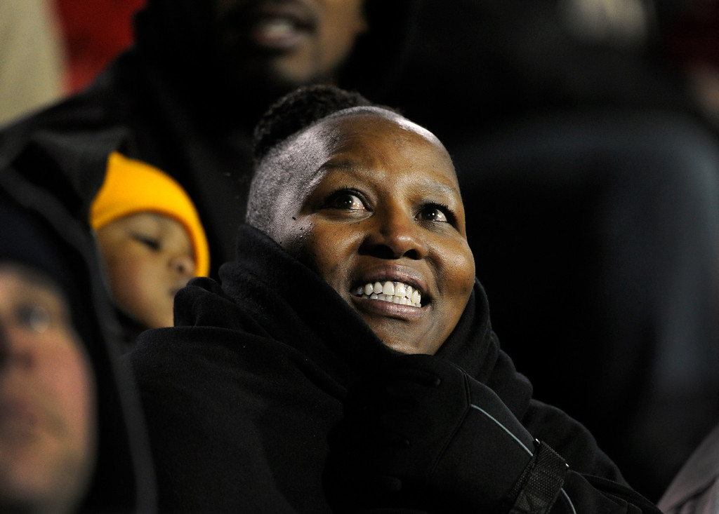 . BOULDER, CO - NOVEMBER 23: Felicia Morris, the mother of senior Derrick Webb, a linebacker for the Colorado Buffaloes football team, watches her son on a replay on the stadium large- screen as he makes a tackle in the game against the Southern California Trojans at Folsom Field in mid-November. It is senior day and the last home game of the season, and each senior player is recognized and greeted by family and friends on the field. (Photo by Kathryn Scott Osler/The Denver Post)