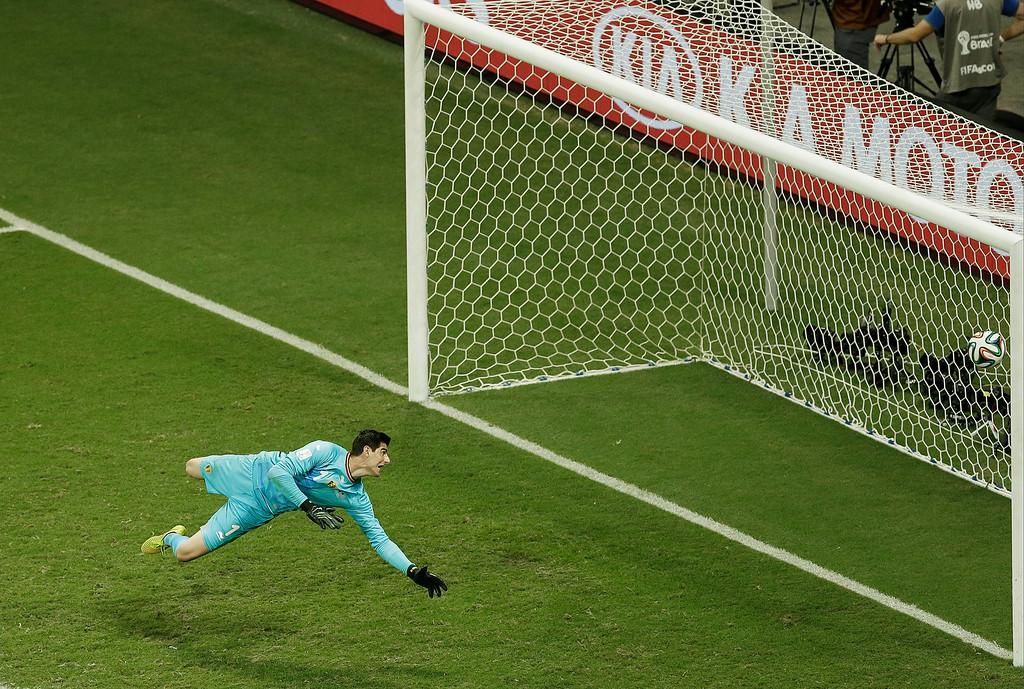 . Belgium\'s goalkeeper Thibaut Courtois looks to the ball crossing the line as United States\' Julian Green scored his side\'s first goal during the World Cup round of 16 soccer match between Belgium and the USA at the Arena Fonte Nova in Salvador, Brazil, Tuesday, July 1, 2014. (AP Photo/Themba Hadebe)
