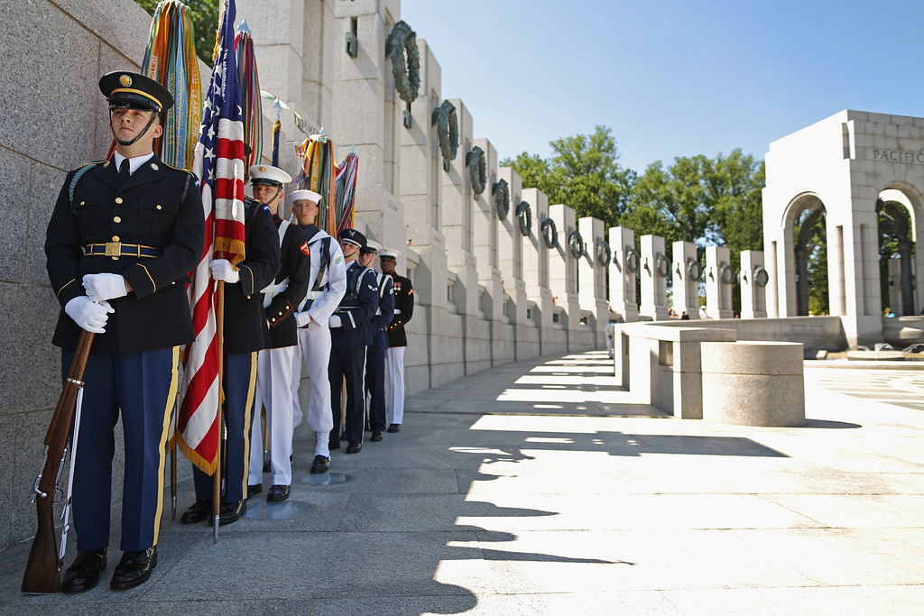 . An honor guard prepares to participate in the 70th anniversary D-Day commemoration at the WWII Memorial on the National Mall June 6, 2014 in Washington, DC. Dozens of WWII veterans participated in the ceremony commemorating the invasion of Normandy by allied troops that turned the tide of the war.  (Photo by Chip Somodevilla/Getty Images)