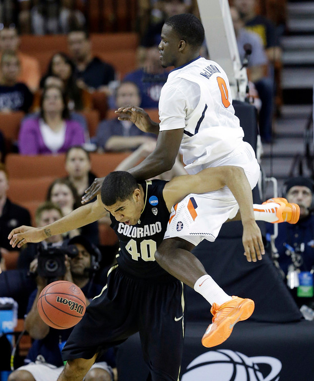 . Illinois\' Sam McLaurin (0) crashes into Colorado\'s Josh Scott (40) during the first half of a second-round game of the NCAA college basketball tournament on Friday, March 22, 2013, in Austin, Texas. (AP Photo/David J. Phillip)