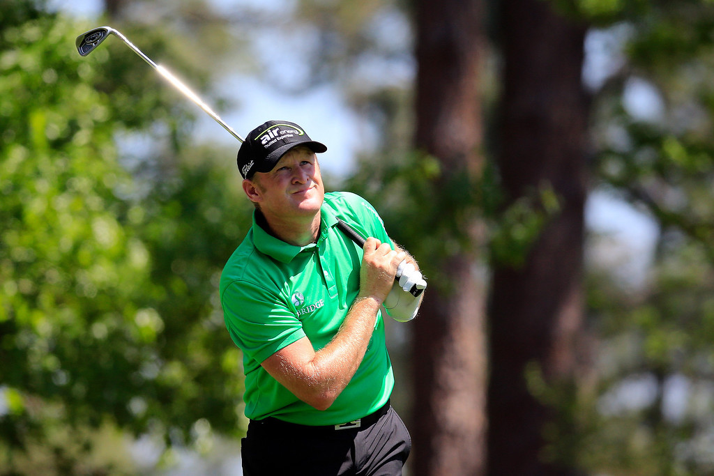 . Jamie Donaldson of Wales watches his tee shot on the fourth hole during the third round of the 2014 Masters Tournament at Augusta National Golf Club on April 12, 2014 in Augusta, Georgia.  (Photo by Rob Carr/Getty Images)