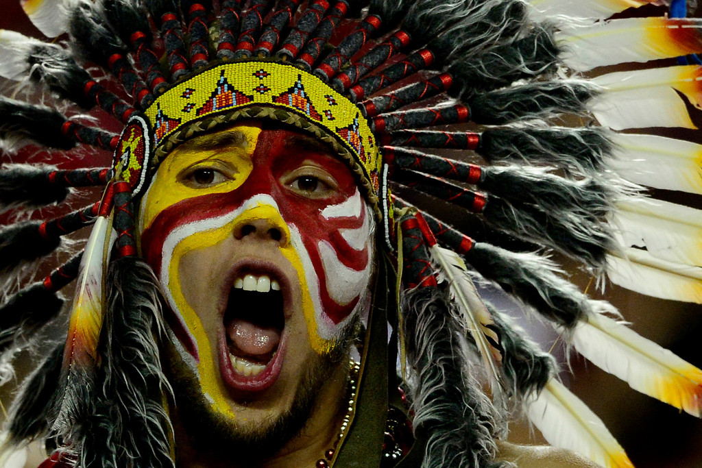 . KANSAS CITY, MO - DECEMBER 01: A Kansas City Chiefs fan cheers his team on against the Denver Broncos during the second half of the Broncos\' 35-28 win at Arrowhead Stadium. The Denver Broncos visit the Kansas City Chiefs in an AFC West showdown. (Photo by AAron Ontiveroz/The Denver Post)