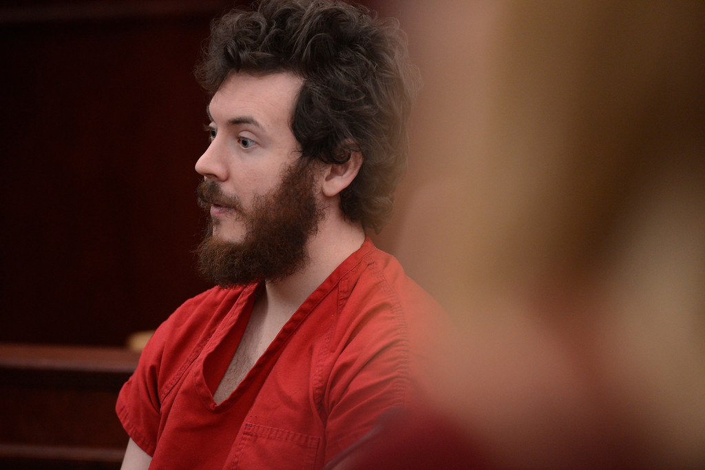 . Aurora theater shooting suspect James Holmes in the courtroom during his arraignment Tuesday March 12, 2013. District Court Judge William Sylvester entered a Not Guilty plea on behalf of Holmes. The trial begins August 5, 2013. (Photo By RJ Sangosti/The Denver Post)