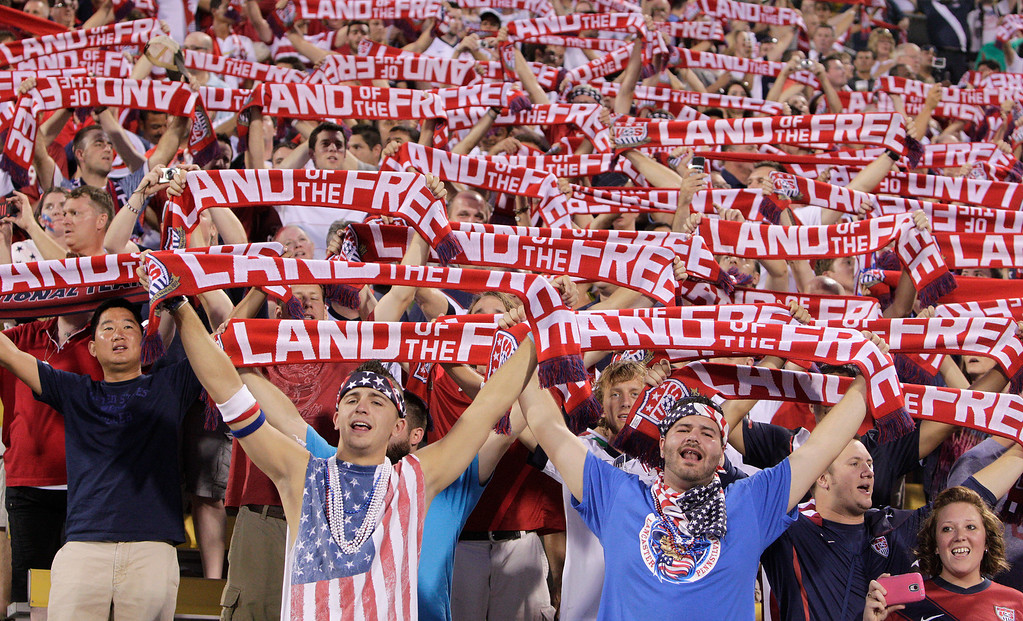 . United States fans hold up scarves as they sing the national Anthem before the start of the qualifying soccer match against Mexico in a World Cup, Tuesday, Sept. 10, 2013, in Columbus, Ohio. (AP Photo/Jay LaPrete)