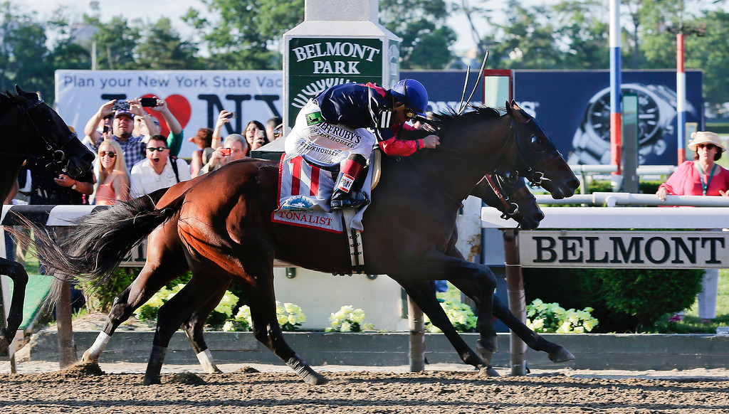 . Tonalist (11) with Joel Rosario up edges out Commissioner with Javier Castellano up to win the 146th running of the Belmont Stakes horse race, Saturday, June 7, 2014, in Elmont, N.Y. Belmont Stakes horse race, Saturday, June 7, 2014, in Elmont, N.Y. (AP Photo/Peter Morgan)