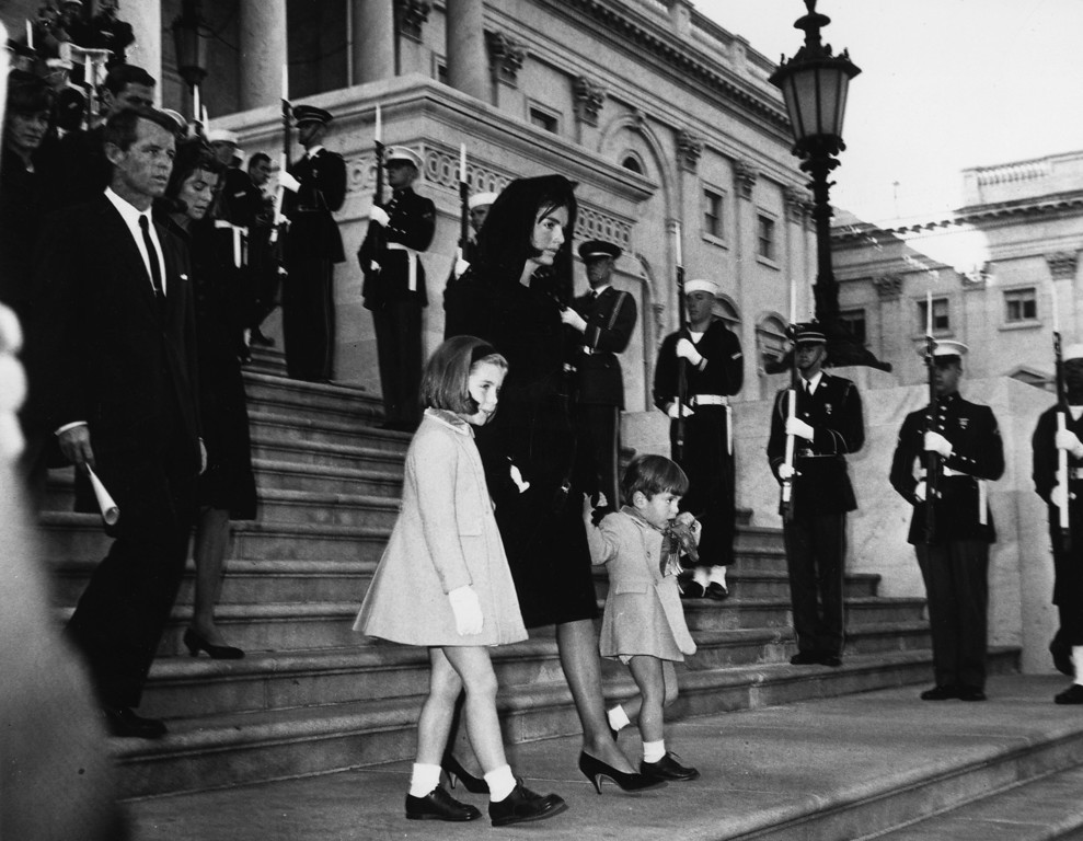 . Jackie Kennedy and children Caroline and John Jr. descend the steps at the funeral. Robert Kennedy  follows them. Central Press/Getty Images