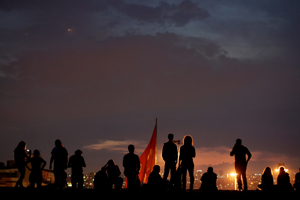 . Protesters  stand on the roof of Ataturk Cultural center during a protest  at Taksim square in Istanbul, Tuesday, June 4, 2013.   (AP Photo/Kostas Tsironis)