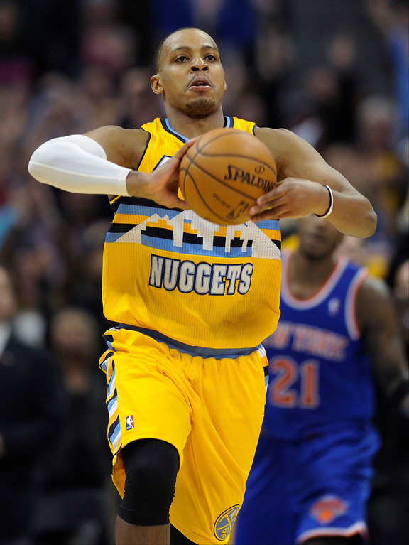 . Denver guard Randy Foye launched the ball down the court after the final buzzer.    Photo By Karl Gehring/The Denver Post