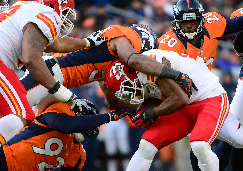 . Kansas City Chiefs running back Shaun Draughn (20) is tacked close to the line in the second quarter as the Denver Broncos took on the Kansas City Chiefs at Sports Authority Field at Mile High in Denver, Colorado on December 30, 2012. AAron Ontiveroz, The Denver Post