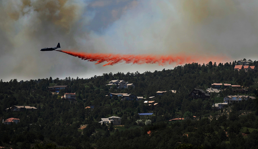 . Waldo Canyon Fire continues to grow on Tuesday, June 26, 2012, near Colorado Springs. An air tanker battles the fire from the air. RJ Sangosti, The Denver Post