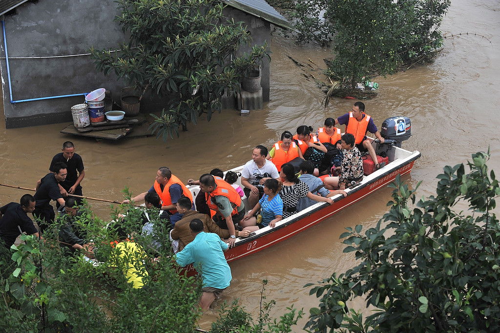 . Rescuers evacuate residents from flood-hit areas on July 9, 2013 in Chengdu, China. At least one person was killed and 15 others missing after severe rainstorms hit Sichuan province on Monday.   ChinaFotoPress via Getty Images