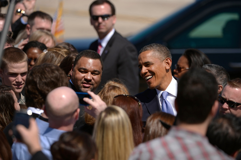 . AURORA, CO- APRIL 3: President Barack Obama shakes hands with invited guests at Buckley Air Force base after  arriving  in Aurora, CO aboard Air Force One at Buckley Air Force Base in Aurora, CO on April 3, 2013. The president traveled to Colorado to meet with local law enforcement officials and community leaders to discuss the new gun control measures that the state has put in place including loopholes in the back round check system. (Photo By Helen H. Richardson/ The Denver Post)