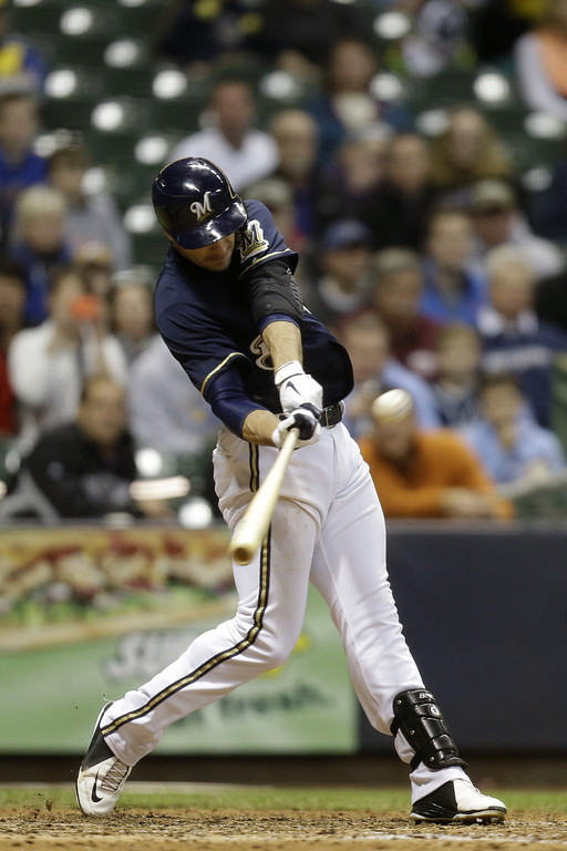 . MILWAUKEE, WI - APRIL 3:  Ryan Braun #8 of the Milwaukee Brewers doubles, scoring Rickie Weeks in the bottom of the seventh inning against the Colorado Rockies at Miller Park on April 3, 2013 in Milwaukee, Wisconsin. (Photo by Mike McGinnis/Getty Images)