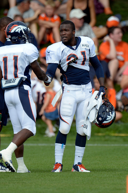 . Denver Broncos WR Trindon Holliday (11) shakes hands with RB Ronnie Hillman (21) during training camp August 1, 2013 at Dove Valley. (Photo By John Leyba/The Denver Post)