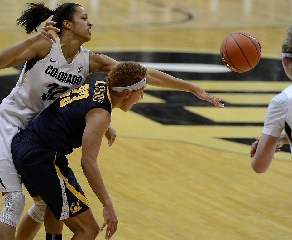 . Colorado Buffaloes forward Arielle Roberson (32) reaches over the back of California Golden Bears guard Layshia Clarendon (23) to knock the ball away late in the second half Sunday, January 6, 2013 at Coors Events Center. The Colorado Buffaloes lost to the California Golden Bears 49-53. John Leyba, The Denver Post