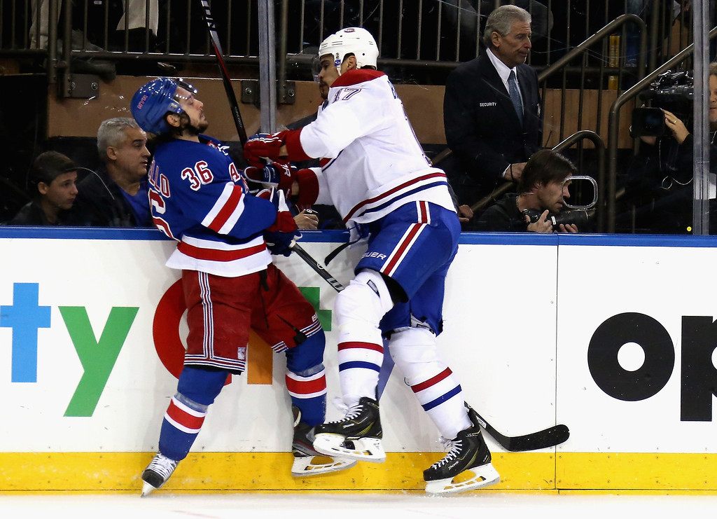 . Rene Bourque #17 of the Montreal Canadiens checks Mats Zuccarello #36 of the New York Rangers during Game Six of the Eastern Conference Final in the 2014 NHL Stanley Cup Playoffs at Madison Square Garden on May 29, 2014 in New York City.  (Photo by Bruce Bennett/Getty Images)