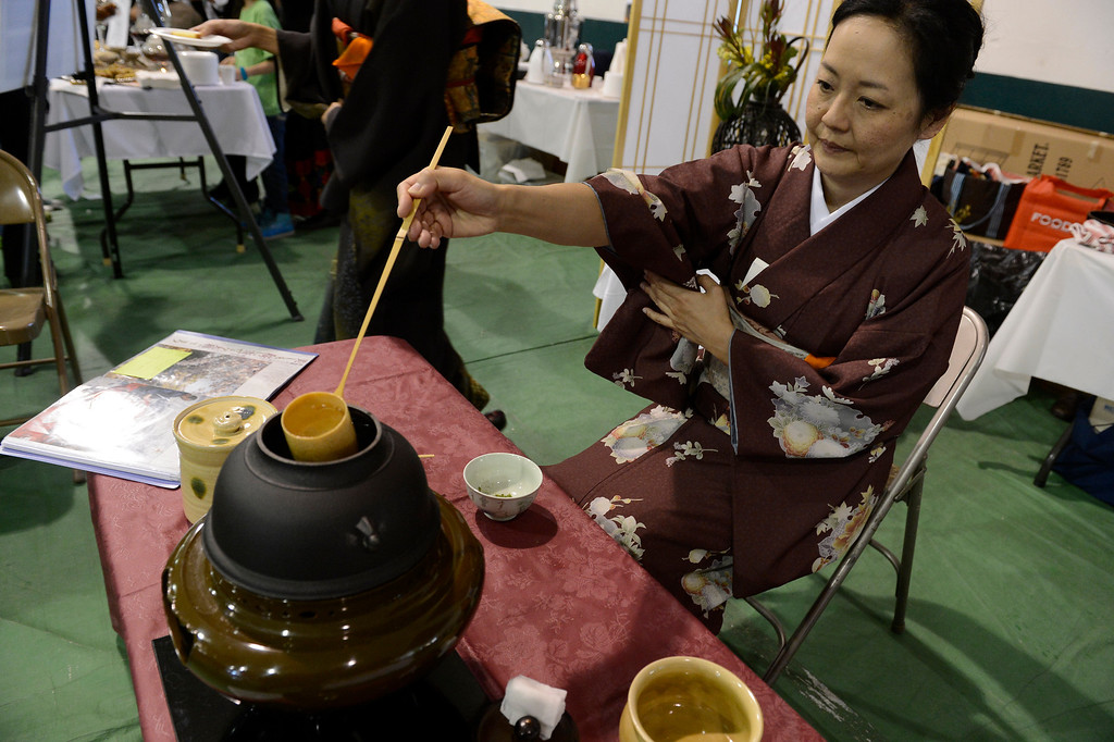 . DENVER, CO. - JANUARY 27: Kazuyo Hanson makes tea during a Japanese Tea ceremony at the World Tea Fair held at Denver Montclair International School January 27, 2013.  There were 12 tables featuring tea samples from around the World.Photo By John Leyba / The Denver Post)