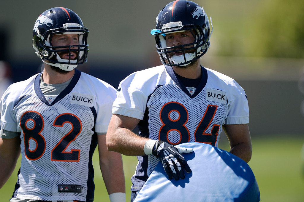 . Denver Broncos tight ends Jameson Konz (82) and Jacob Tamme (84) run through drills during OTAs  June 2, 2014 at Dove Valley. (Photo by John Leyba/The Denver Post)