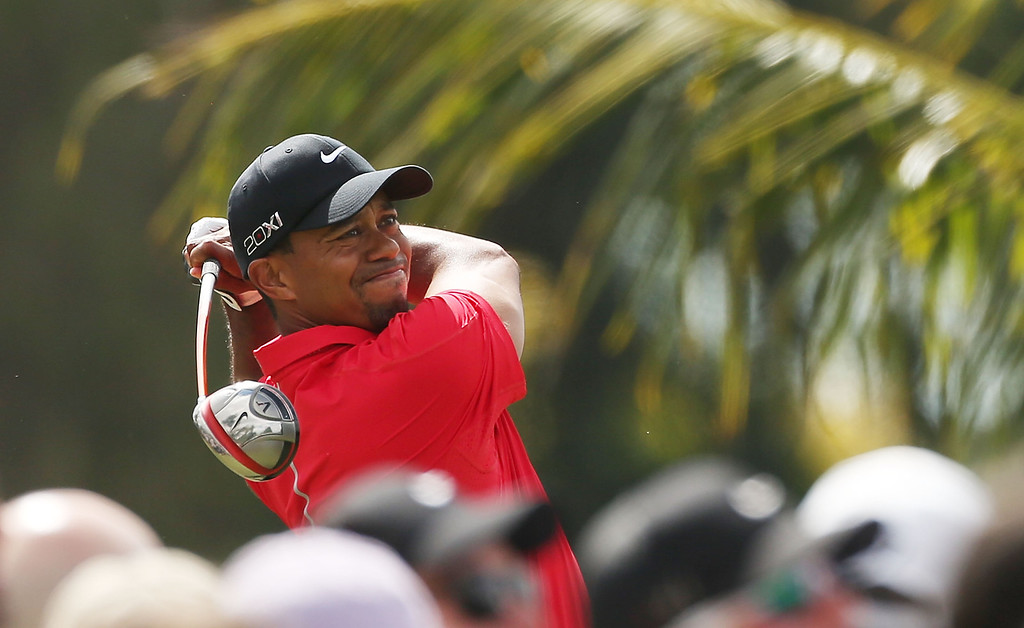 . DORAL, FL - MARCH 10:  Tiger Woods hits his tee shot on the third hole during the final round of the World Golf Championships-Cadillac Championship at the Trump Doral Golf Resort & Spa on March 10, 2013 in Doral, Florida.  (Photo by Warren Little/Getty Images) *** BESTPIX ***