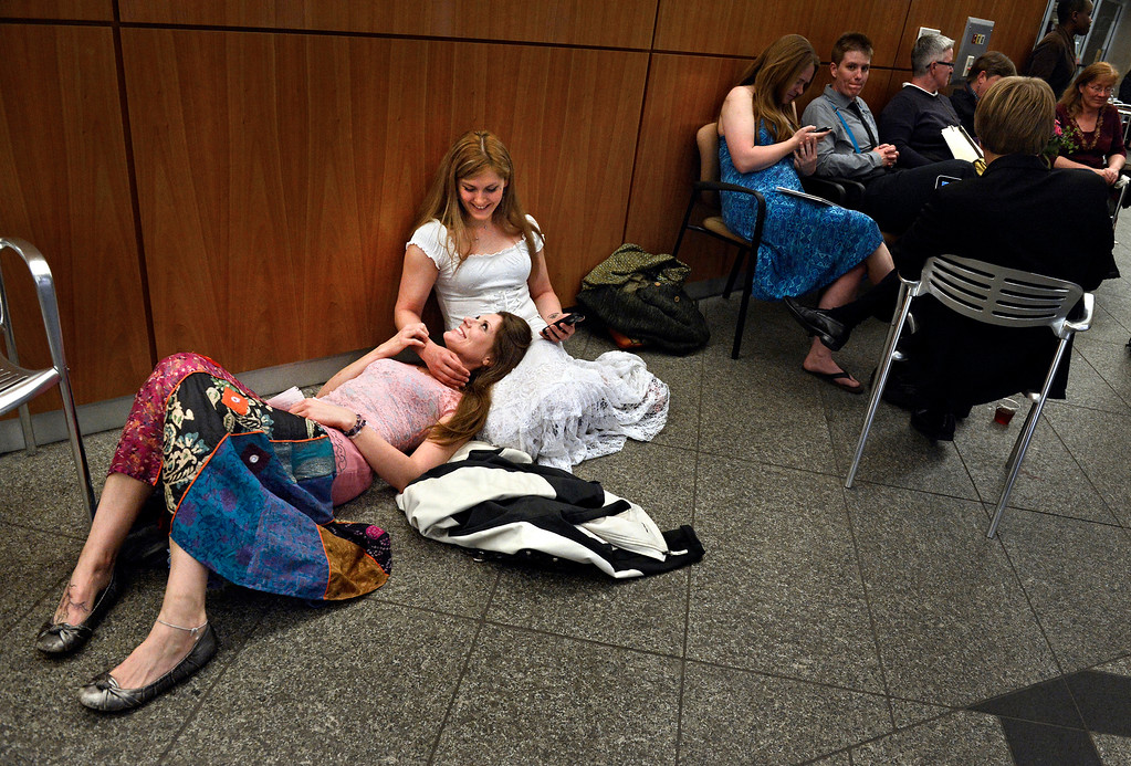 ". At 3:30 a.m., Sarah Mutter, left, and Isabel Aguirre wait to apply for their civil-union license outside the Clerk and Recorder\'s office in Denver. ""Other people get to say fiancee and wife, and all we can say is girlfriend or partner,\"" said Sarah, who made her commitment a government affair Wednesday morning with her partner of four years. Isabel added: \""This is a big step � for us to be taken as legally accepted.\"""