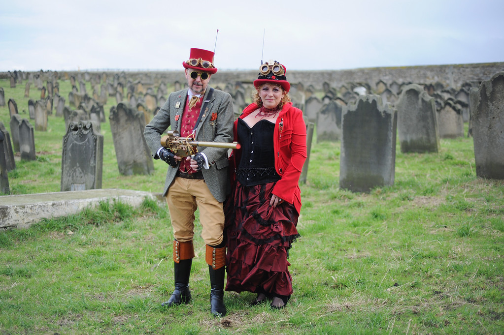 . WHITBY, ENGLAND - NOVEMBER 02: Les Rogers, a social care manager and his wife Caron, a support worker, from Goole dress as steampunks at the Goth weekend on November 2, 2013 in Whitby, England. The Whitby Gothic Weekend that takes place in the Yorkshire seaside town twice yearly in Spring and Autumn started in 1994 and sees thousands of extravagantly dressed followers of Victoriana, Steampunk, Cybergoth and Romanticism visit to take part in celebrating Gothic culture.  (Photo by Ian Forsyth/Getty Images)