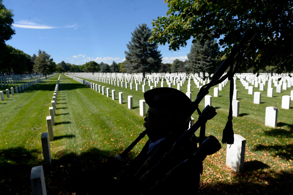 . DENVER, CO. - OCTOBER 02:Jay Leasure tunes his bagpipes before a burial ceremony for Colorado National Guard Special Forces Soldier Liam Nevins at Fort Logan National Cemetery in Denver,CO October 02, 2013. (Photo By Craig F. Walker / The Denver Post)