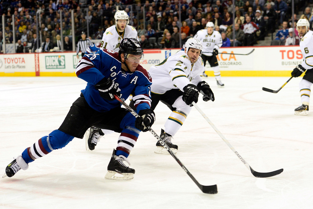 . DENVER, CO. - FEBRUARY 4: Aaron Rome (27) of the Dallas Stars defends as Paul Stastny (26) of the Colorado Avalanche takes a shot during the first period of action. Colorado Avalanche versus the Dallas Stars at the Pepsi Center on February 4, 2012. (Photo By AAron Ontiveroz/The Denver Post)