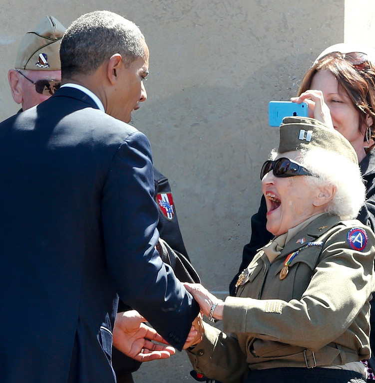 . A World War Two veteran, second right, meets U.S. President Barack Obama as they participate in the 70th French-American commemoration D-Day ceremony at the Normandy American Cemetery and Memorial in Colleville-sur-Mer, France on Friday, June 6, 2014. World leaders and veterans gathered by the beaches of Normandy on Friday to mark the 70th anniversary of World War Two\'s D-Day landings. (AP Photo/Pascal Rossignol, Pool)