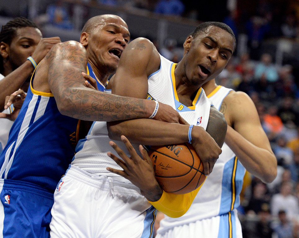 . DENVER, CO - APRIL 16: Golden State Warriors forward Marreese Speights (5) and Denver Nuggets forward Quincy Miller (30) battle for the rebound during the fourth quarter April 16, 2014 at Pepsi Center. Golden State Warriors defeated the Denver Nuggets 116-112. (Photo by John Leyba/The Denver Post)