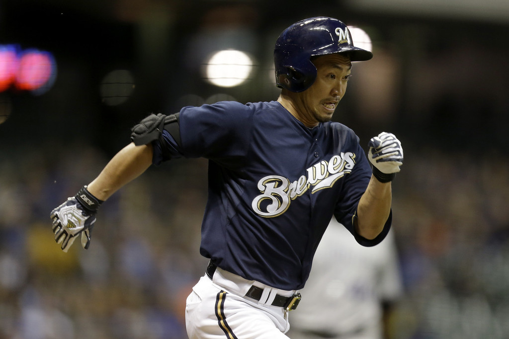 . MILWAUKEE, WI - APRIL 3:  Norichika Aoki #7 of the Milwaukee Brewers cannot beat the throw while running to first base in the bottom of the first inning against the Colorado Rockies during the game at Miller Park on April 3, 2013 in Milwaukee, Wisconsin.  (Photo by Mike McGinnis/Getty Images)
