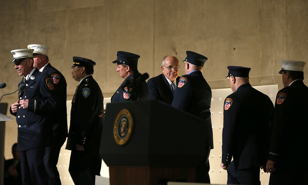 . Former New York City Mayor Rudy Giuliani (C) greets first responders to the scene of the World Trade Center attacks on September 11, 2001, during the opening ceremony for the National September 11 Memorial Museum at ground zero May 15, 2014 in New York City.  (Photo by Mike Segar-Pool/Getty Images)