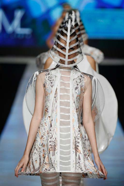 . A model shows a creation by Indonesian designer M.V.Lydia  during the Jakarta Fashion Week in Jakarta, Indonesia, Monday, Oct. 21, 2013. (AP Photo/Achmad Ibrahim)