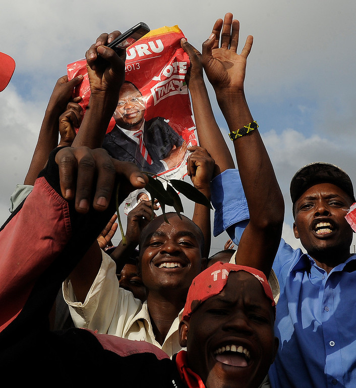 . Supporters of Kenyan presidential candidate Uhuru Kenyatta celebrate after the announcement of his victory in Kenya\'s national elections on March 9, 2013 in Kiambu.   AFP PHOTO / SIMON MAINA/AFP/Getty Images