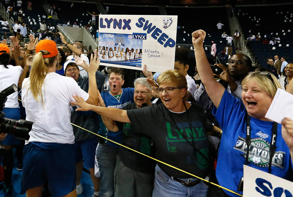 . ATLANTA, GA - OCTOBER 10:  Fans of the Minnesota Lynx cheer after their 86-77 win over the Atlanta Dream in Game Three of the 2013 WNBA Finals at Philips Arena on October 10, 2013 in Atlanta, Georgia.  (Photo by Kevin C. Cox/Getty Images)