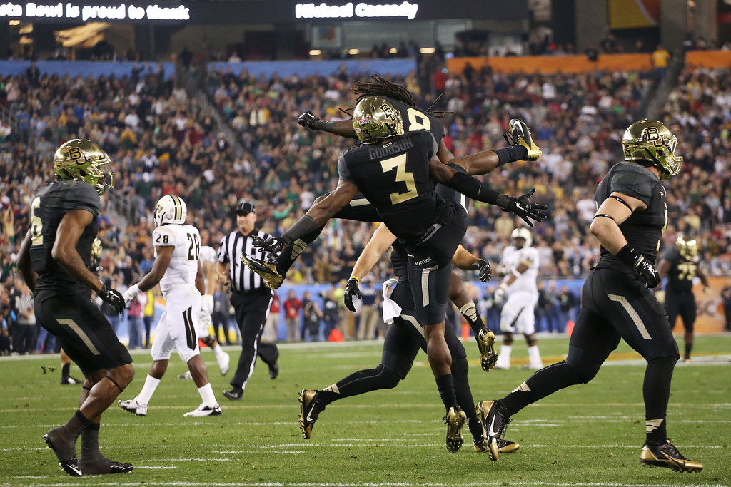 . GLENDALE, AZ - JANUARY 01:  Demetri Goodson #3 of the Baylor Bears celebrates with teammates after his second quarter interception against the UCF Knights during the Tostitos Fiesta Bowl at University of Phoenix Stadium on January 1, 2014 in Glendale, Arizona.  (Photo by Christian Petersen/Getty Images)
