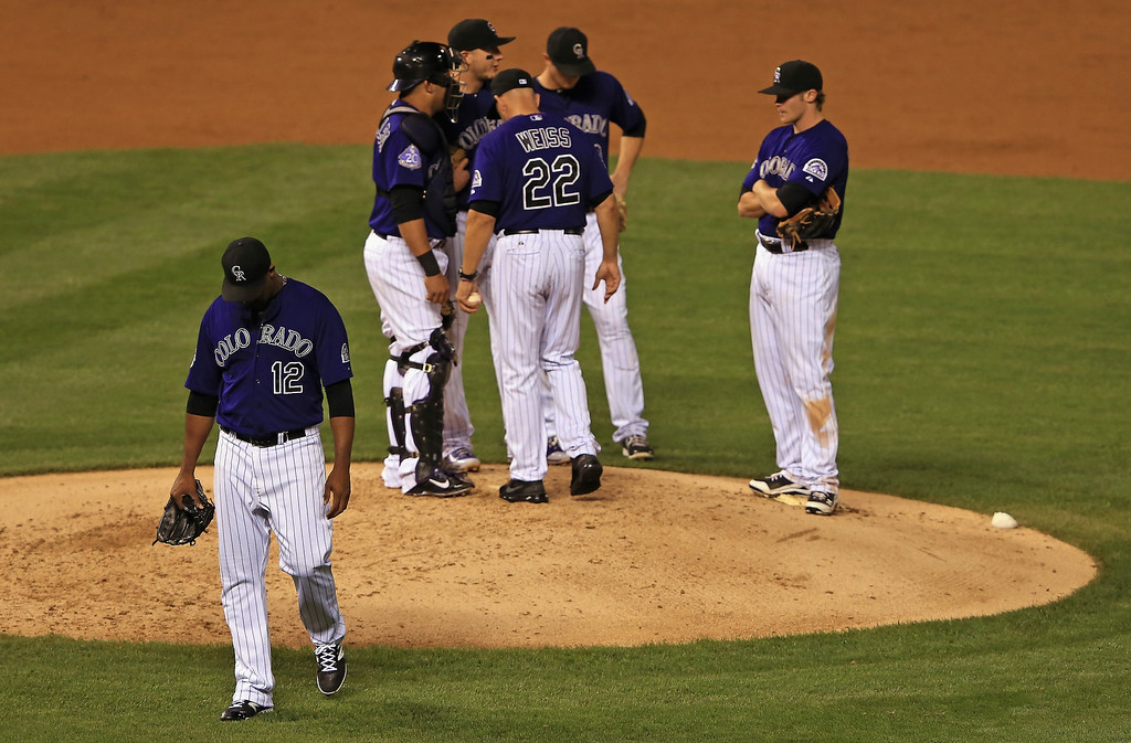 . Manager Walt Weiss #22 of the Colorado Rockies removes starting pitcher Juan Nicasio #12 of the Colorado Rockies from the game in the third inning at Coors Field on September 17, 2013 in Denver, Colorado.  (Photo by Doug Pensinger/Getty Images)