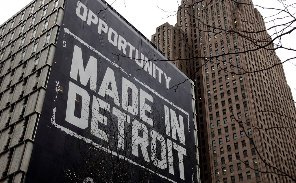 ". A large ""Opportunity Made In Detroit\"" banner is seen on the side of a building in downtown Detroit, Michigan in this January 30, 2013 file photo. Detroit filed the largest-ever municipal bankruptcy in U.S. history on July 18, 2013, marking a new low for a city that was the cradle of the U.S. automotive industry and setting the stage for a costly court battle with creditors. To match story USA-DETROIT/  REUTERS/Rebecca Cook/Files"