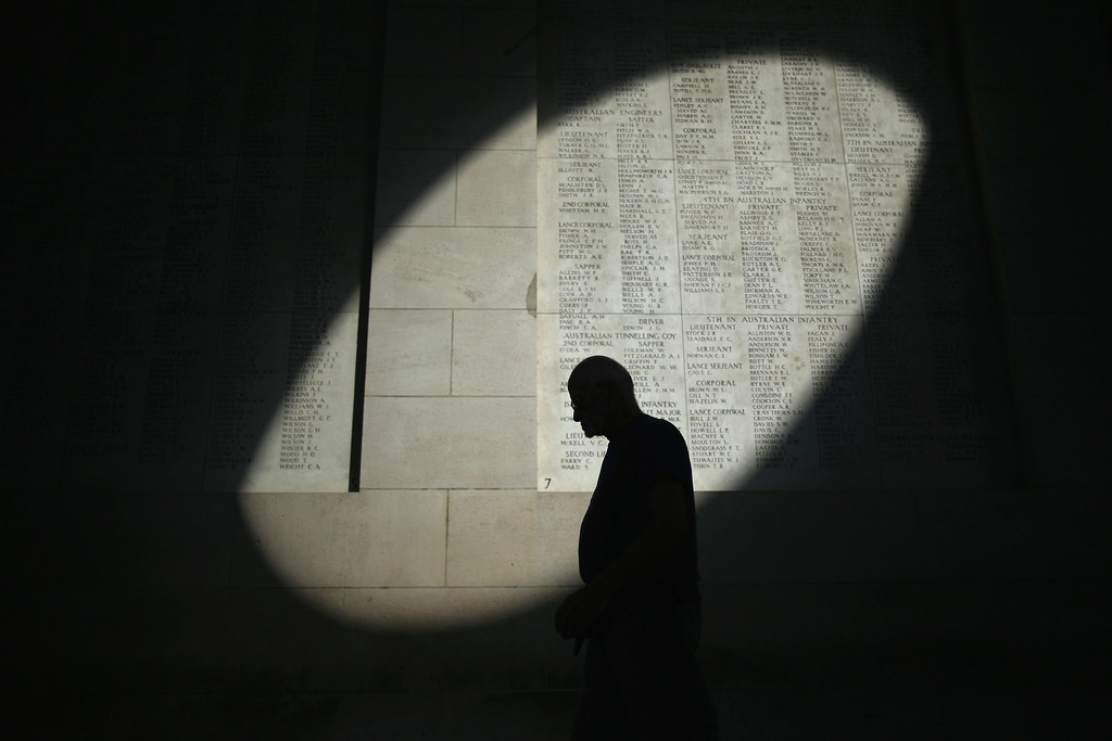 . YPRES, BELGIUM - AUGUST 04:  A shaft of sunlight falls on the names of the missing at the Menin Gate Memorial on the centenary of the Great War on August 4, 2014 in Ypres, Belgium. Today marks the 100th anniversary of Great Britain declaring war on Germany. In 1914 British Prime Minister Herbert Asquith announced at 11 pm that Britain was to enter the war after Germany had violated Belgium neutrality. The First World War or the Great War lasted until 11 November 1918 and is recognised as one of the deadliest historical conflicts with millions of causalities. A series of events commemorating the 100th anniversary are taking place throughout the day.  (Photo by Christopher Furlong/Getty Images)