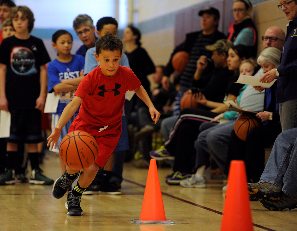. DENVER, CO. - FEBRUARY 23: Bennett Pegues, 8, moves through the cones in the dribbling skill test. The Tamarac Optimist Club sponsors one of the Tri-Star Basketball Competitions at the Eisenhower Recreation Center in Denver. The competitions are held over a several week period for boys and girls 8-13 years-old. The winners from this competition go on to the regional finals, and those winners will play in the final competition on Mar. 23, 2013 at the Pepsi Center before a Nuggets game. There are still several opportunities for kids to try out. Go to www.tristarbasketball.org for upcoming times and locations. (Photo By Kathryn Scott Osler/The Denver Post)