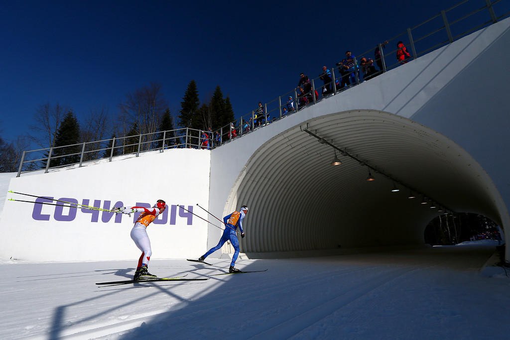 . Graeme Killick of Canada and Aivar Rehemaa of Estonia compete in the Men\'s 4 x 10 km Relay during day nine of the Sochi 2014 Winter Olympics at Laura Cross-country Ski & Biathlon Center on February 16, 2014 in Sochi, Russia.  (Photo by Clive Mason/Getty Images)
