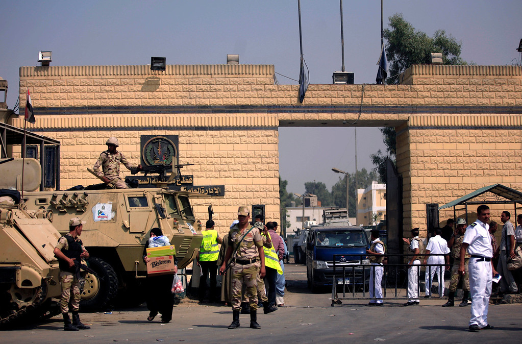 . Egyptian army soldiers guard Torah Prison, where Egypt\'s deposed autocrat Hosni Mubarak has been held, in Cairo, Egypt, Thursday, Aug. 22, 2013. Egypt\'s ousted leader Hosni Mubarak has been released from jail and taken to military hospital in Cairo. (AP Photo/Khalil Hamra)