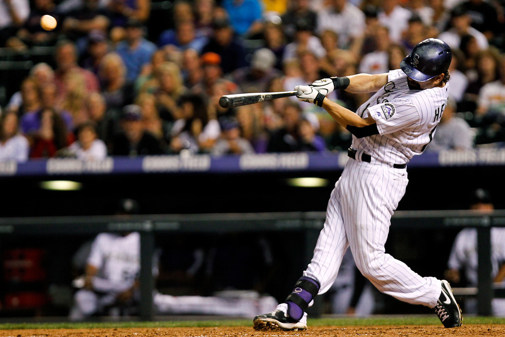 . Colorado Rockies\' Todd Helton hits a three-run home run on a pitch by Cincinnati Reds\' Logan Ondrusek during the seventh inning of a baseball game, Friday, Aug. 30, 2013, in Denver. (AP Photo/Barry Gutierrez)