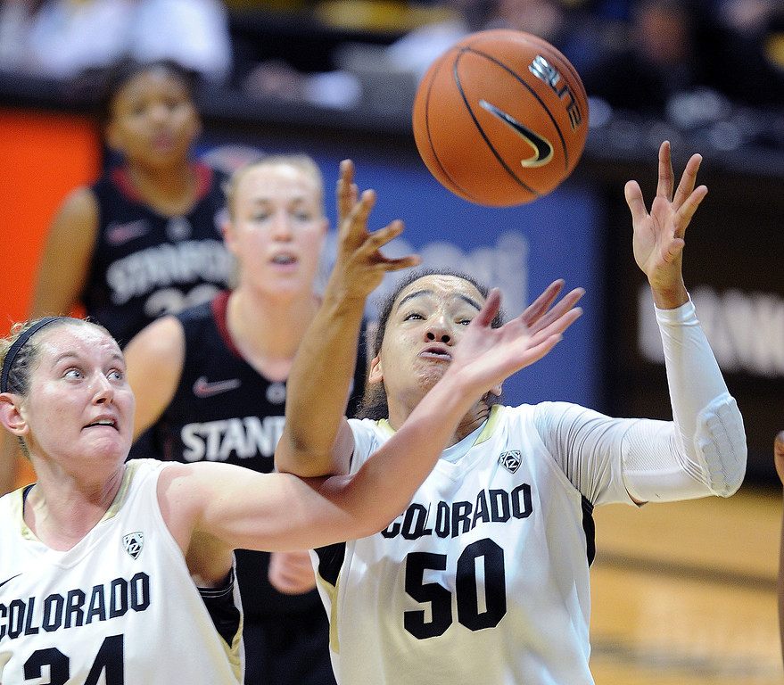 . Jen Reese and Jamee Swan collect a rebound  against Stanford  during the second half of the January 12, 2014 game in Boulder. Cliff Grassmick/Daily Camera