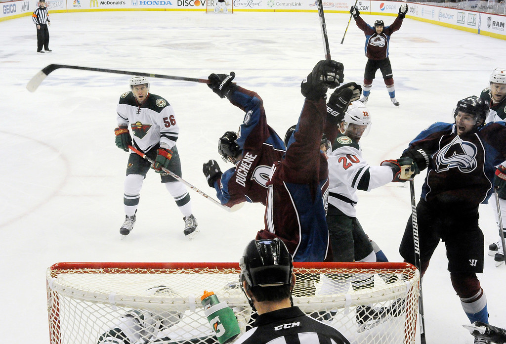 . Colorado Avalanche defenseman Nick Holden (2) celebrates his goal with Colorado Avalanche left wing Jamie McGinn (11) during the first period.   (Photo by John Leyba/The Denver Post)