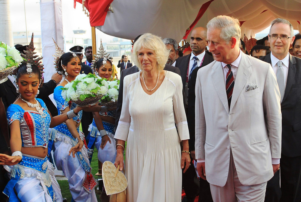 . In this handout photograph received from the Sri Lankan President\'s Office on November 14, 2013, Britain\'s Prince Charles (R) walks with his wife Camilla, the Duchess of Cornwall as they are greeted by dancers upon their arrival in Colombo to head the Commonwealth Heads of Government meeting on November 14, 2013.  Following a low-key visit largely unremarked upon in the Indian media, the future king will be thrown into the limelight on November 15 when he takes the queen\'s place at the Commonwealth Heads of Government summit.   AFP PHOTO /SRI LANKAN PRESIDENTS OFFICE/AFP/Getty Images