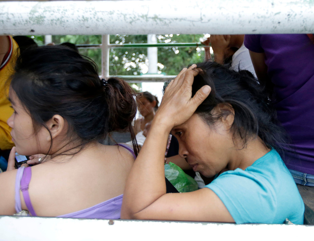 . Earthquake victims wait for treatment at a government hospital following a 7.2-magnitude quake that hit Cebu city in central Philippines Tuesday, Oct. 15, 2013.  (AP Photo/Bullit Marquez)