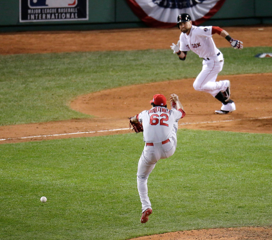 . St. Louis Cardinals relief pitcher Carlos Martinez can\'t catch a ball hit by Boston Red Sox\'s Jacoby Ellsbury, right, during the eighth inning of Game 2 of baseball\'s World Series Thursday, Oct. 24, 2013, in Boston. (AP Photo/Charlie Riedel)