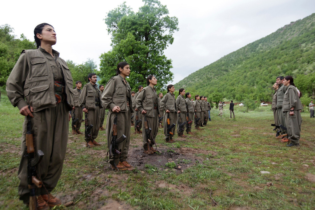 . Kurdistan Workers Party (PKK) fighters stand at formation in northern Iraq May 14, 2013. The first group of Kurdish militants to withdraw from Turkey under a peace process entered northern Iraq on Tuesday, and were greeted by comrades from the Kurdistan Workers Party (PKK), in a symbolic step towards ending a three-decades-old insurgency. The 13 men and women, carrying guns and with rucksacks on their backs, arrived in the area of Heror, near Metina mountain on the Turkish-Iraqi border, a Reuters witness said. REUTERS/Azad Lashkari
