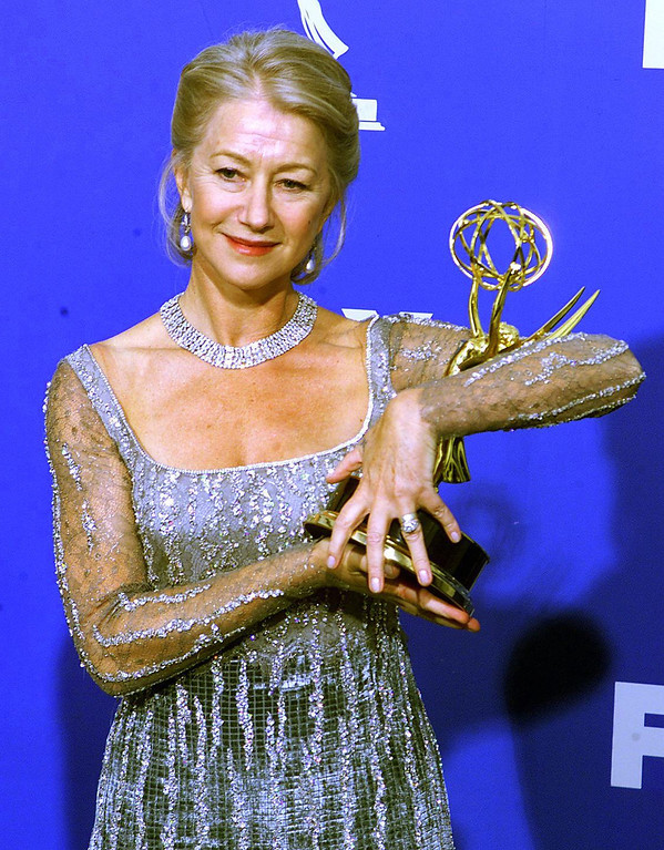". British actress Helen Mirren cradles the Emmy Award she won for Outstanding Lead Actress in a Miniseries or a Movie for her role in ""The Passion of Ayn Rand\"", at the Shrine Auditorium in Los Angeles, CA, 12 September, 1999.   Scott Nelson/AFP/Getty Images"